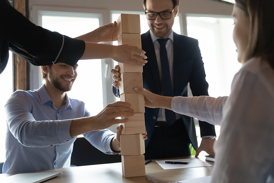 Workers participating in corporate team building exercise