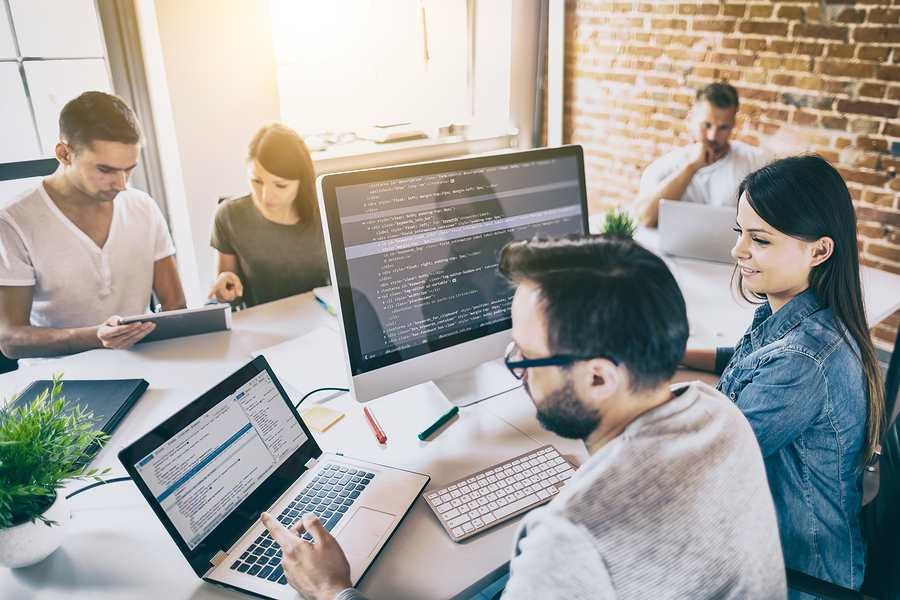 Managed IT services Sydney company workers while coding