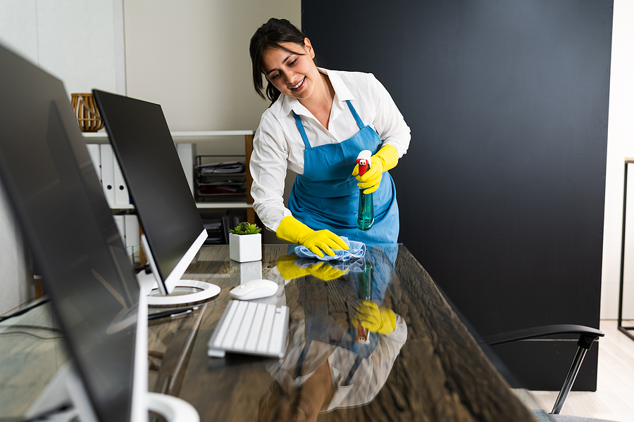 Female janitor offering commercial cleaning services in Sydney