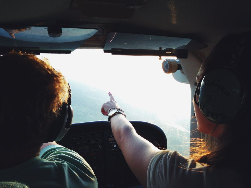 Man and woman taking helicopter pilot training