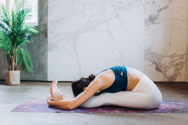 Woman taking online yoga courses